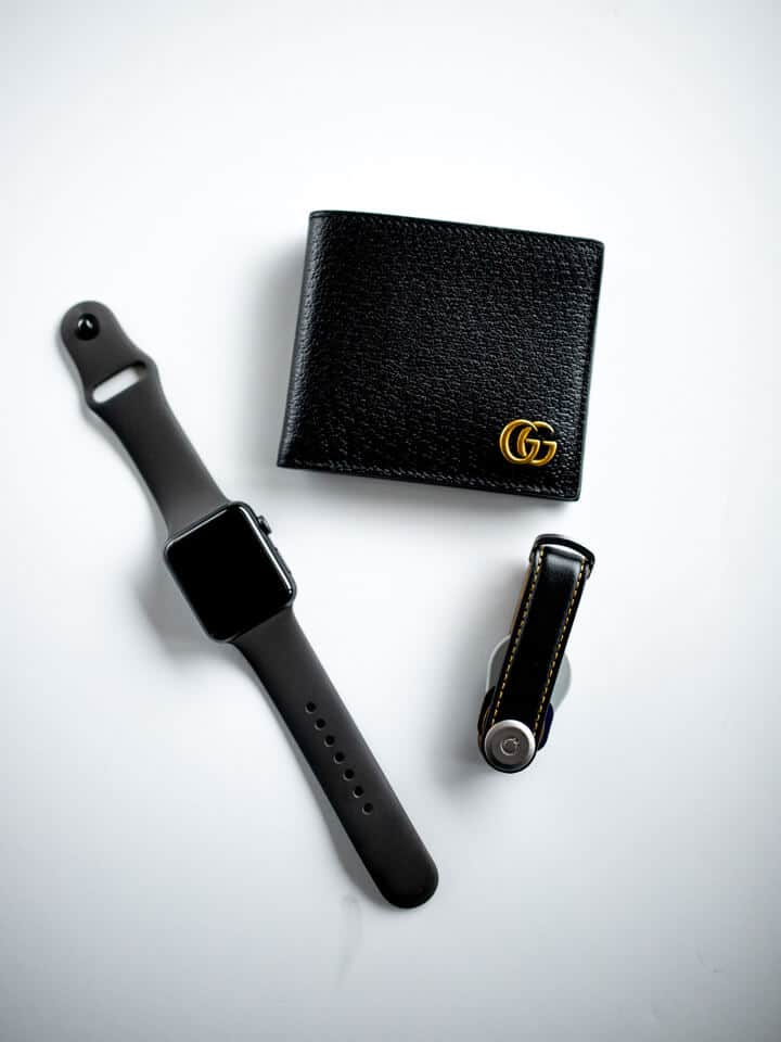 A wallet, watch and keychain.