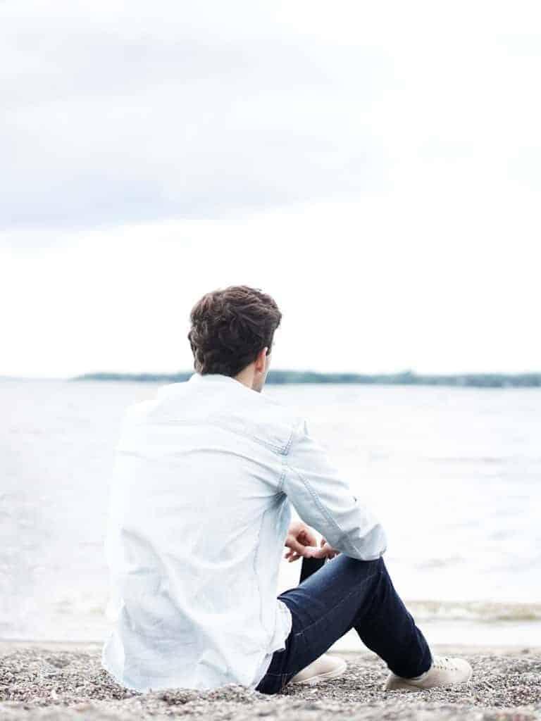 A man sitting on the beach.