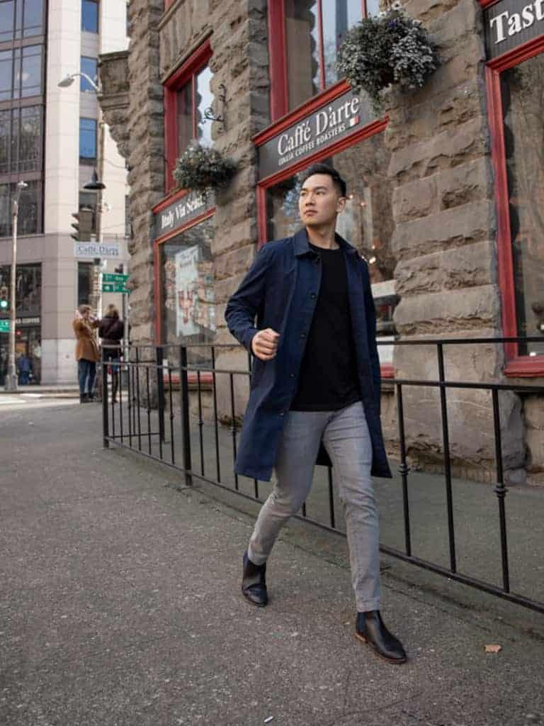 A man walking on the sidewalk.