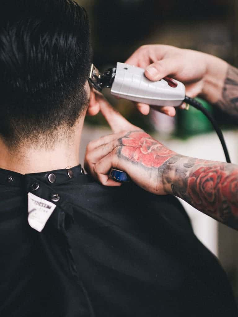 Close-up of a person getting a haircut.