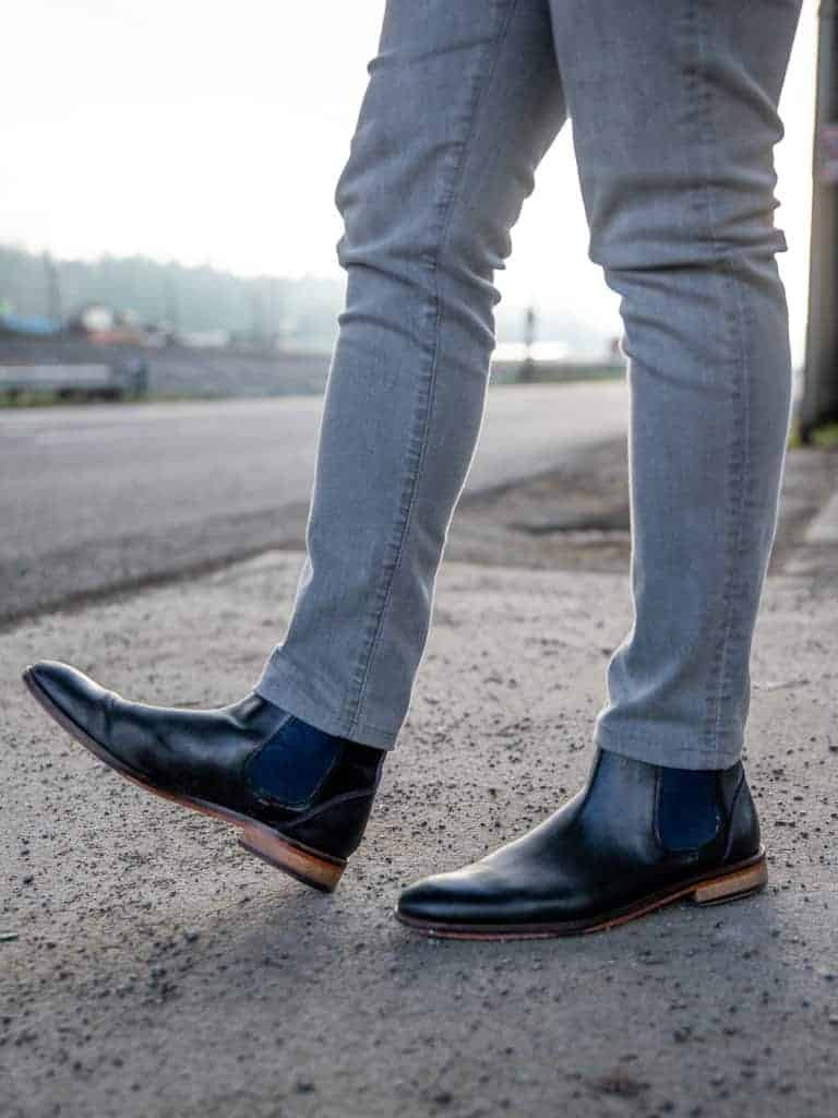 Grey jeans and black Chelsea boots.