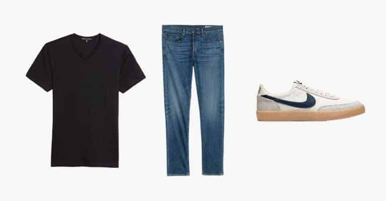 Collection of a black v-neck t-shirt, blue jeans, and white sneaker with a gum sole.