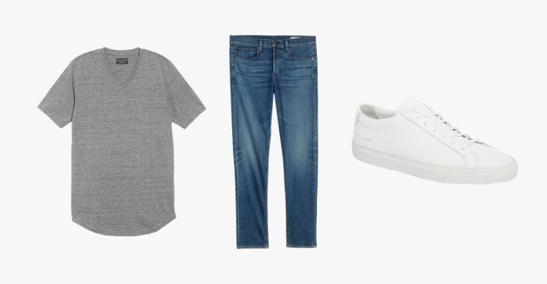 Collection of a grey v-neck t-shirt, blue jeans, and a white sneaker.