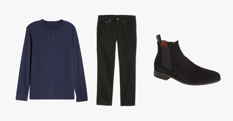Collection of a navy blue henley, black jeans, and black suede Chelsea boots.