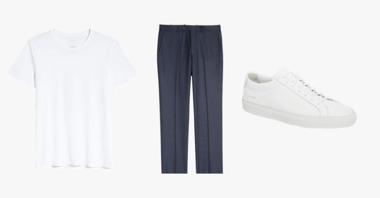 Collection of a white t-shirt, navy trousers, and white sneaker.