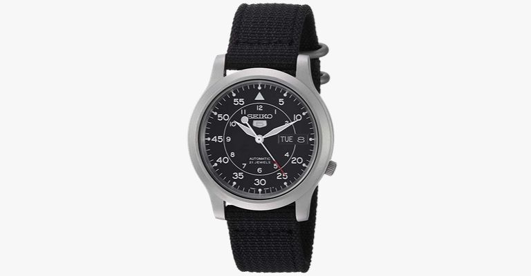 A silver watch with a black canvas strap.
