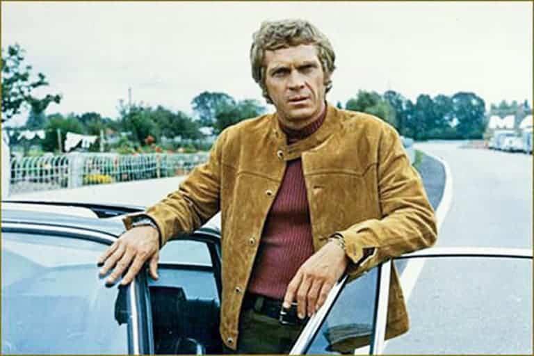 Steve McQueen wearing a suede jacket.
