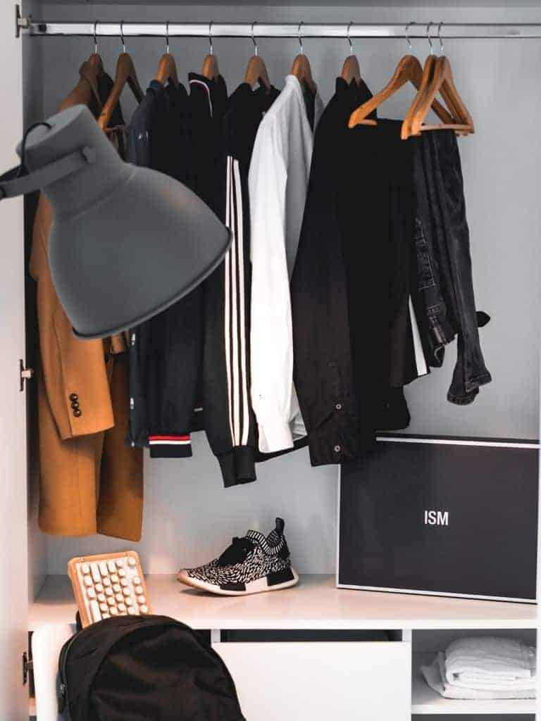 Minimal closet with a few clothes hanged.