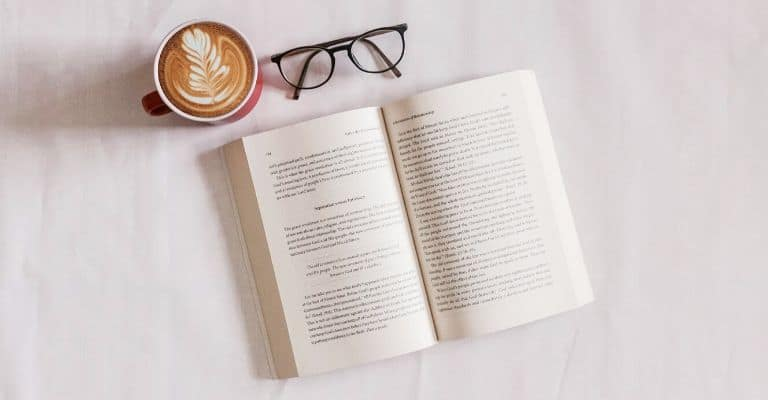 Book, glasses, and coffee.