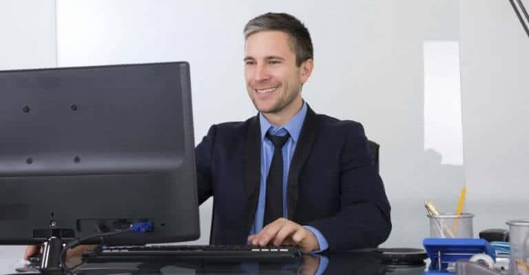 Example of good posture while sitting at a desk.