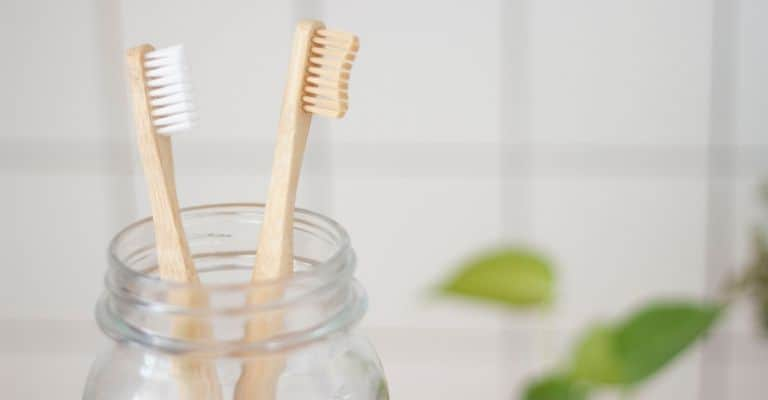 Toothbrushes in a Mason jar.