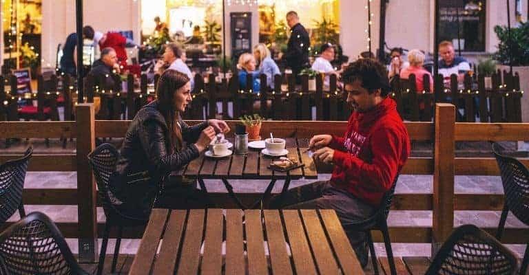 Couple eating outside.