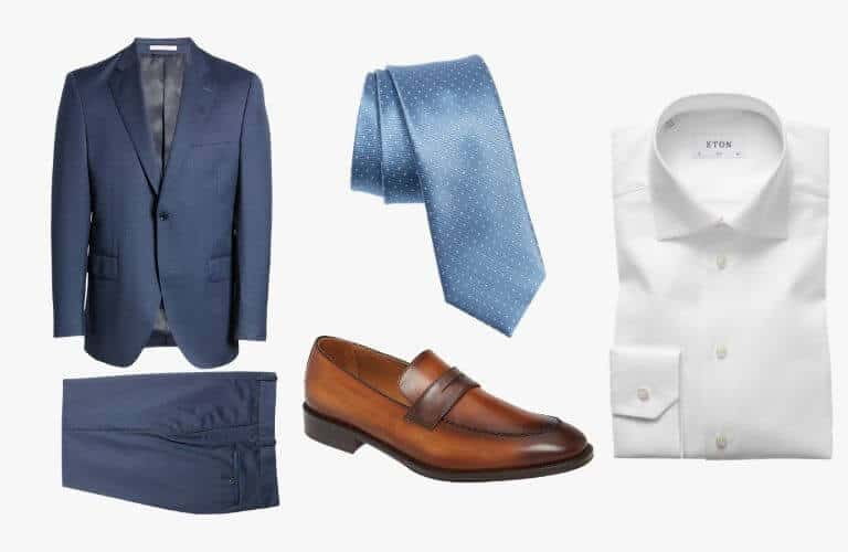 Blue suit, tie, white dress shirt, and brown penny loafer.