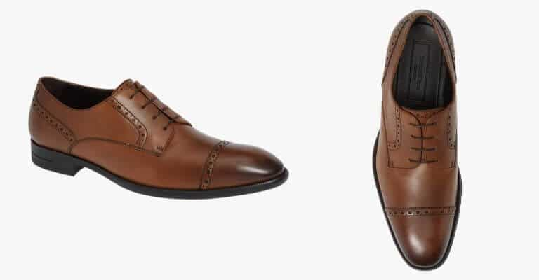 Brown leather cap-toe derby shoe.