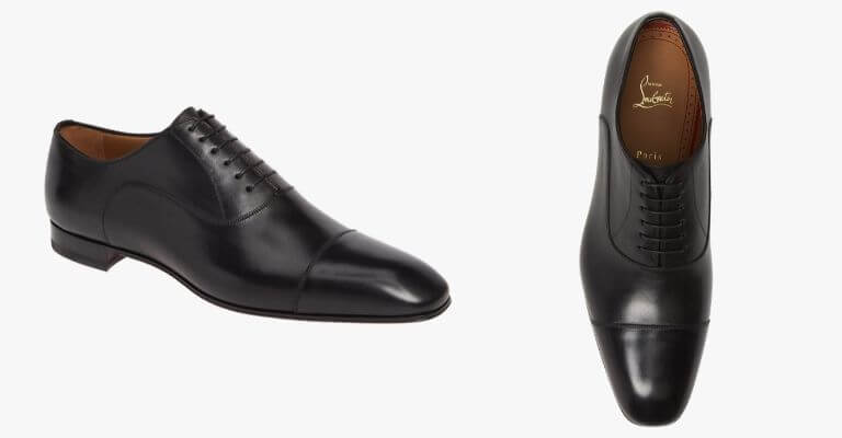 Black cap toe Oxford shoes.