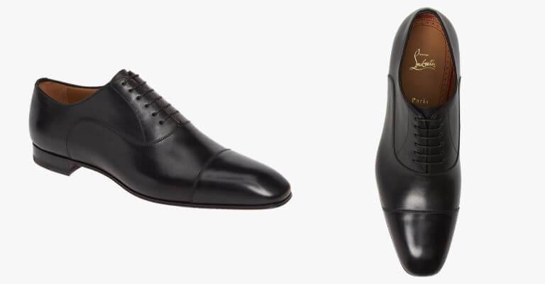 Black cap toe Oxford shoes.