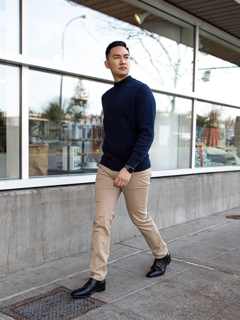 Person walking on a sidewalk.
