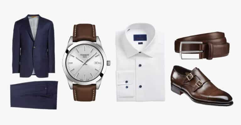 Navy blue suit, white shirt and brown accessories.