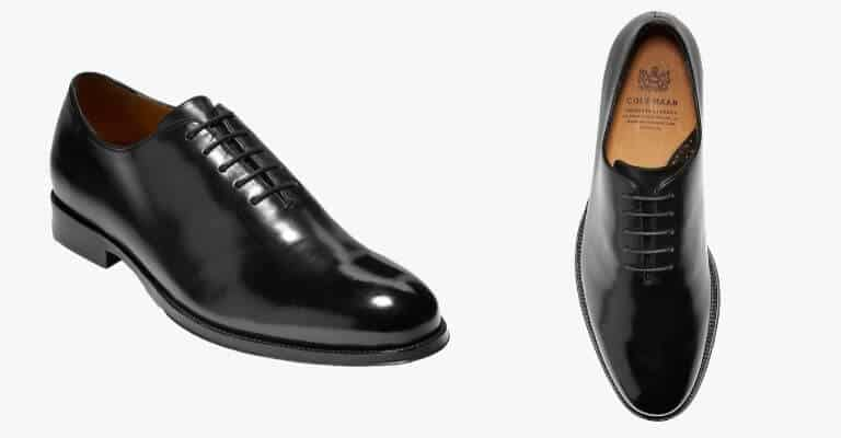 Black whole cut Oxford shoes.
