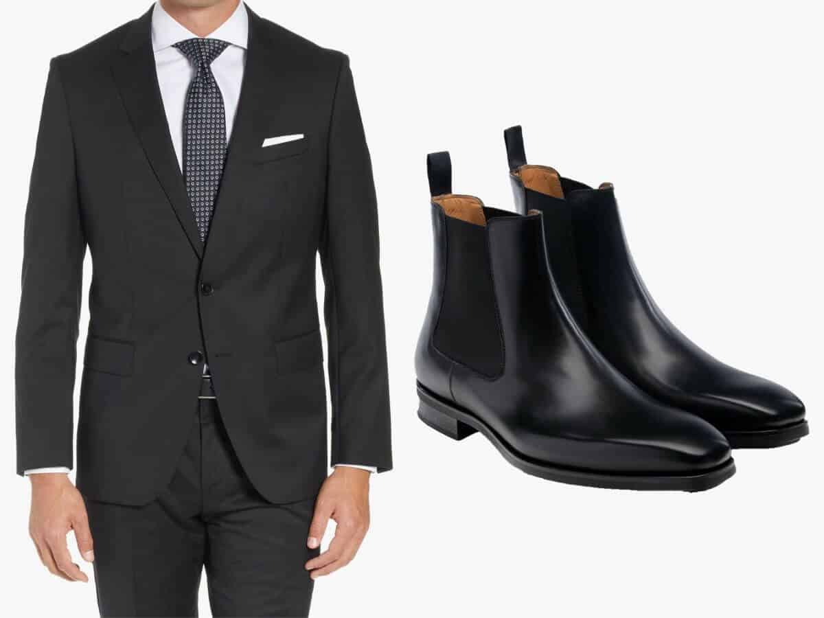 Black suit with black leather Chelsea boots.