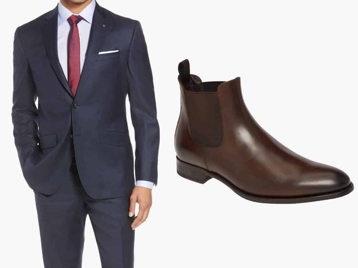 Blue suit with brown leather Chelsea boots.