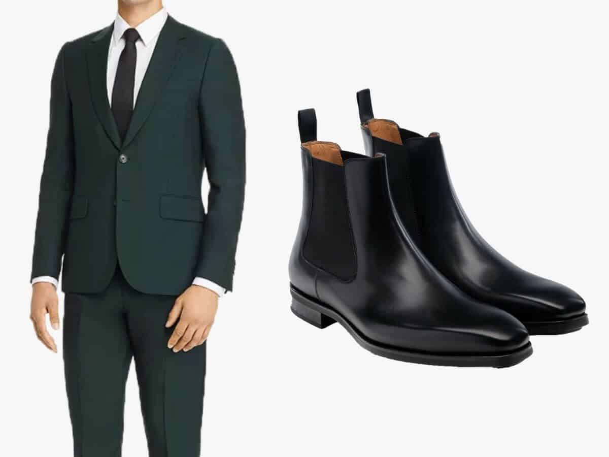 Green suit with black leather Chelsea boots.