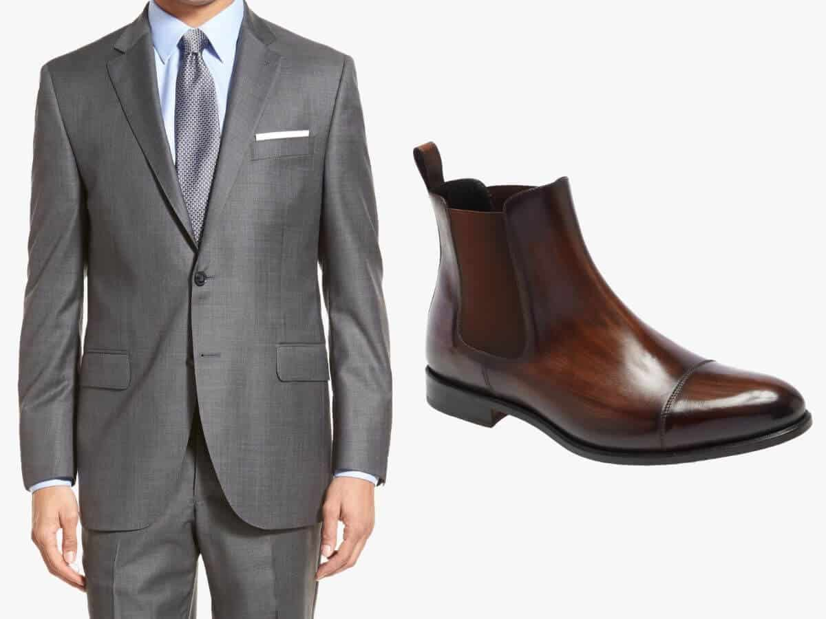 Grey suit with brown leather Chelsea boots.