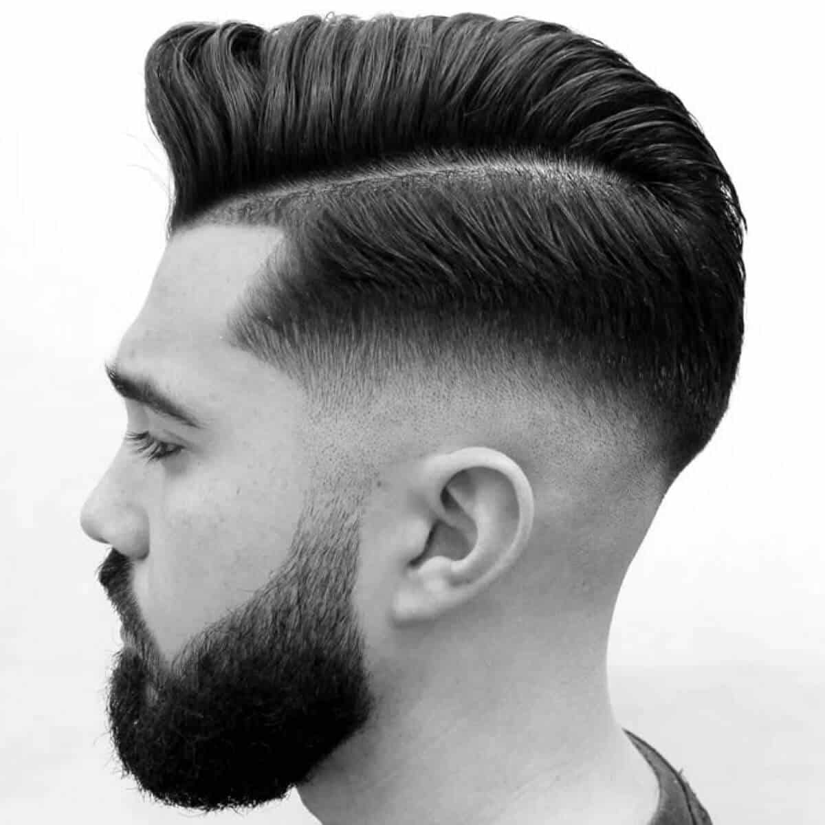 Side profile showing a comb over haircut.