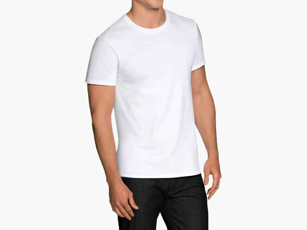Person wearing a white Fruit of the Loom crewneck undershirt.