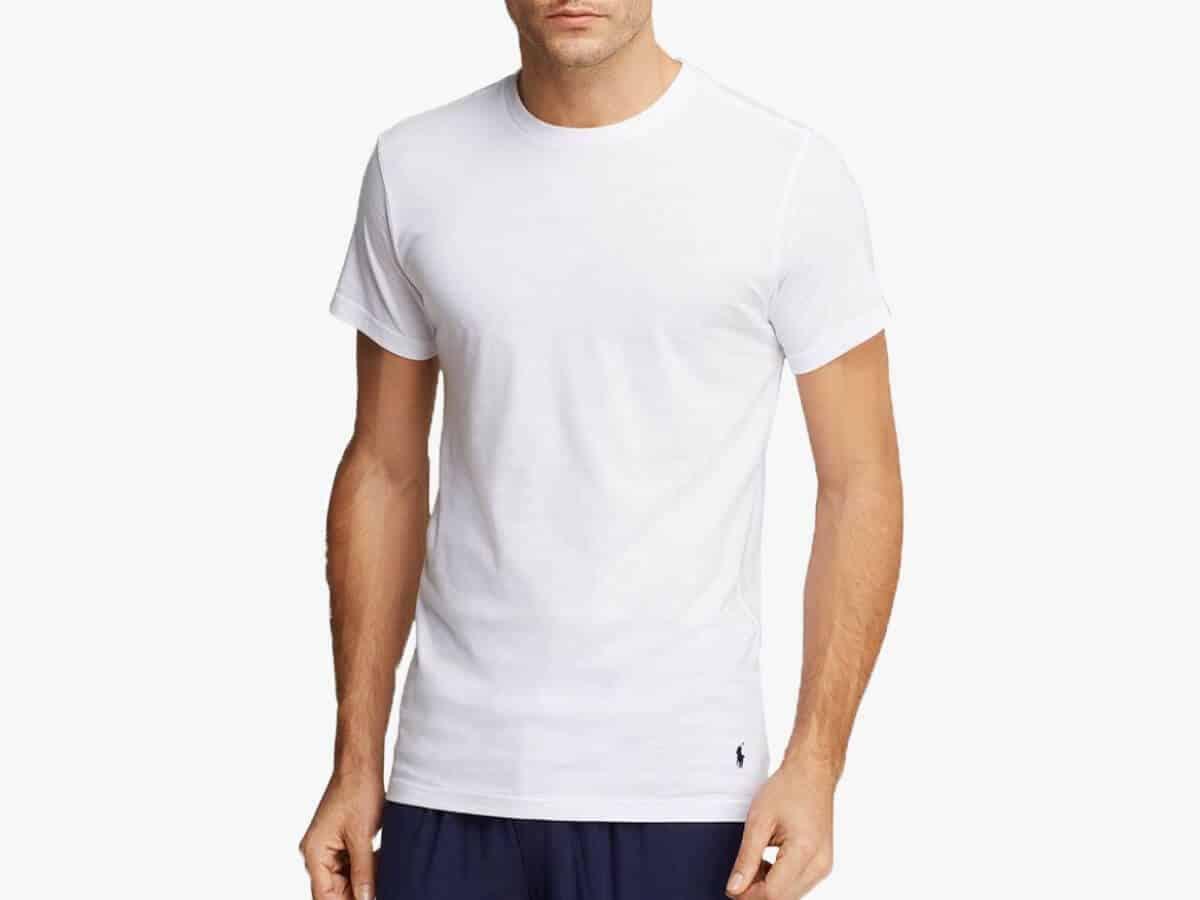 Person wearing a white crewneck undershirt.