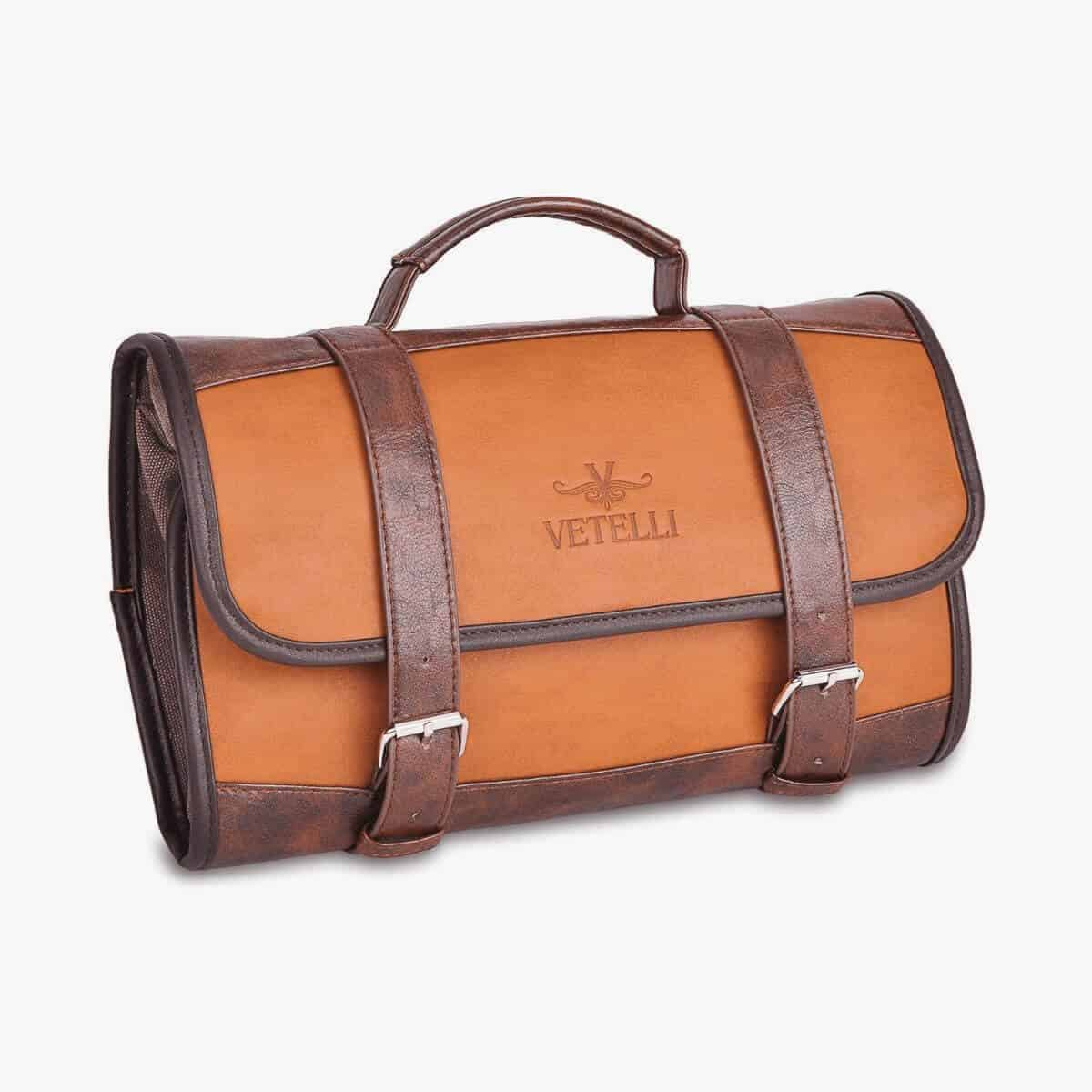 Brown leather hanging toiletry bag with handle.