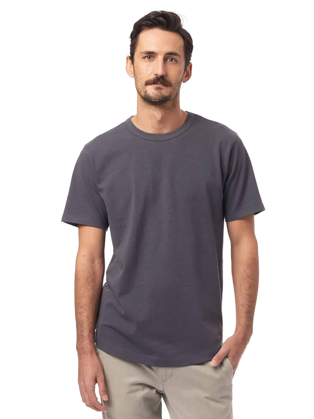 Person wearing a grey t-shirt and beige pants.