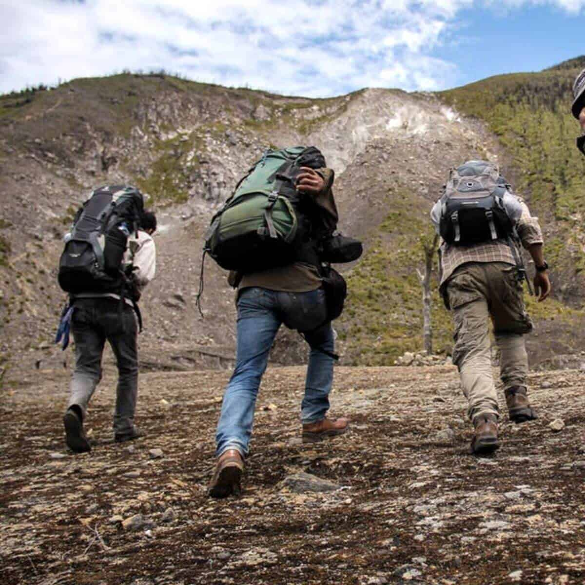 Three people rucking.