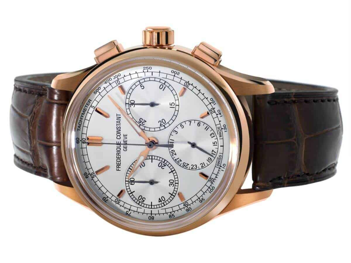 Frederique Constant chronograph watch with a gold case and brown leather strap.