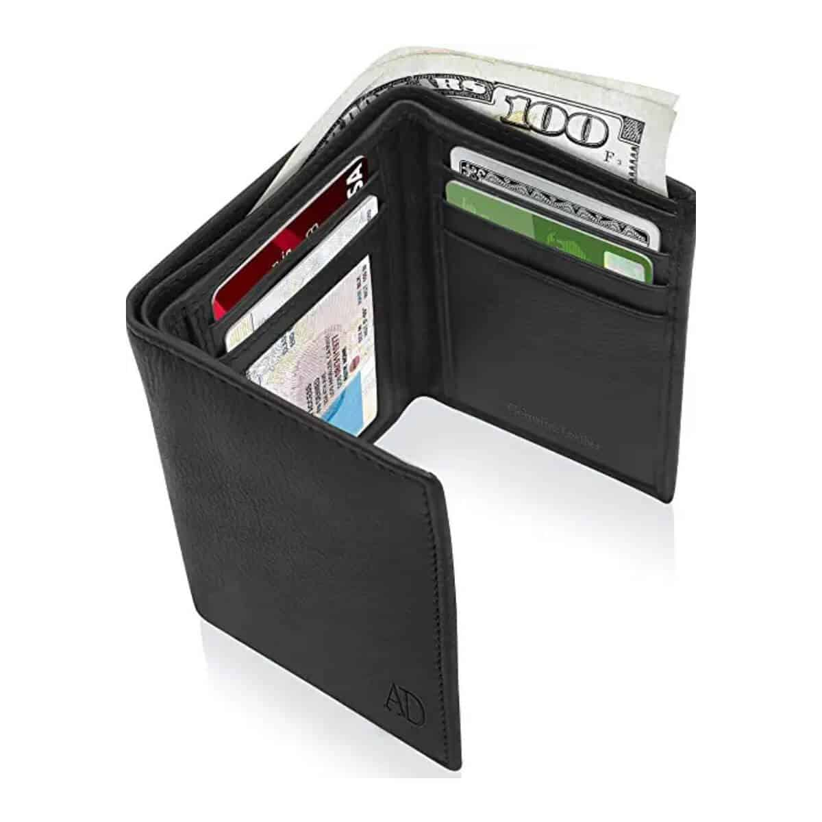 Black leather tri-fold wallet with cards and cash in it.