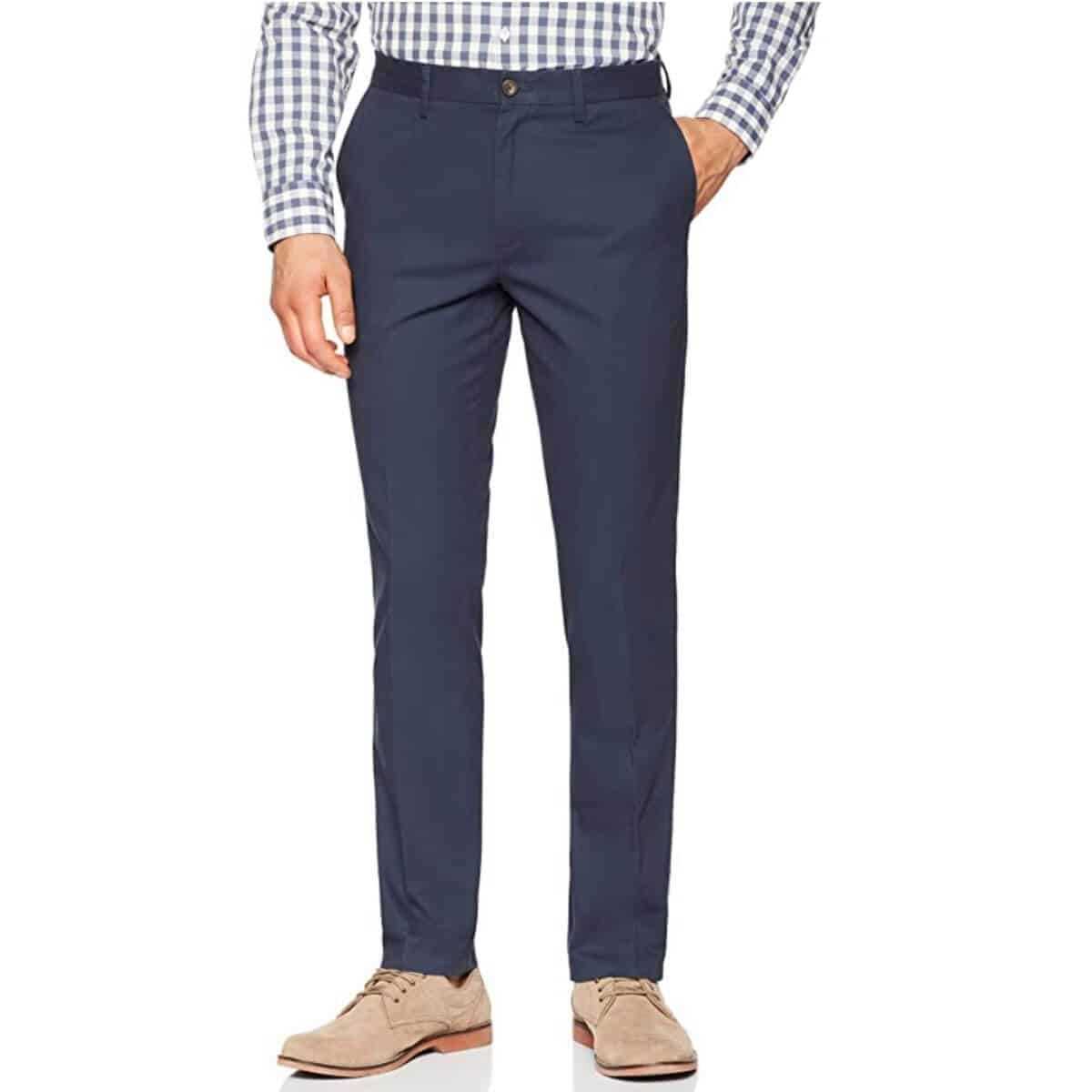 Person wearing a button-up and navy blue chino pants.