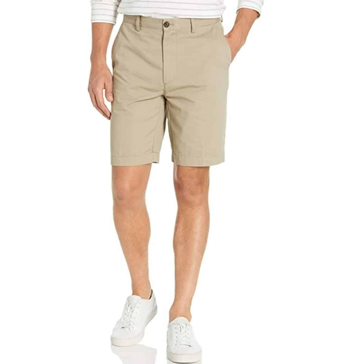 Bottom half of a person wearing shorts.