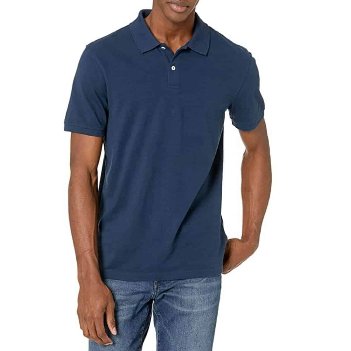 Top half of a person wearing a polo shirt and jeans.