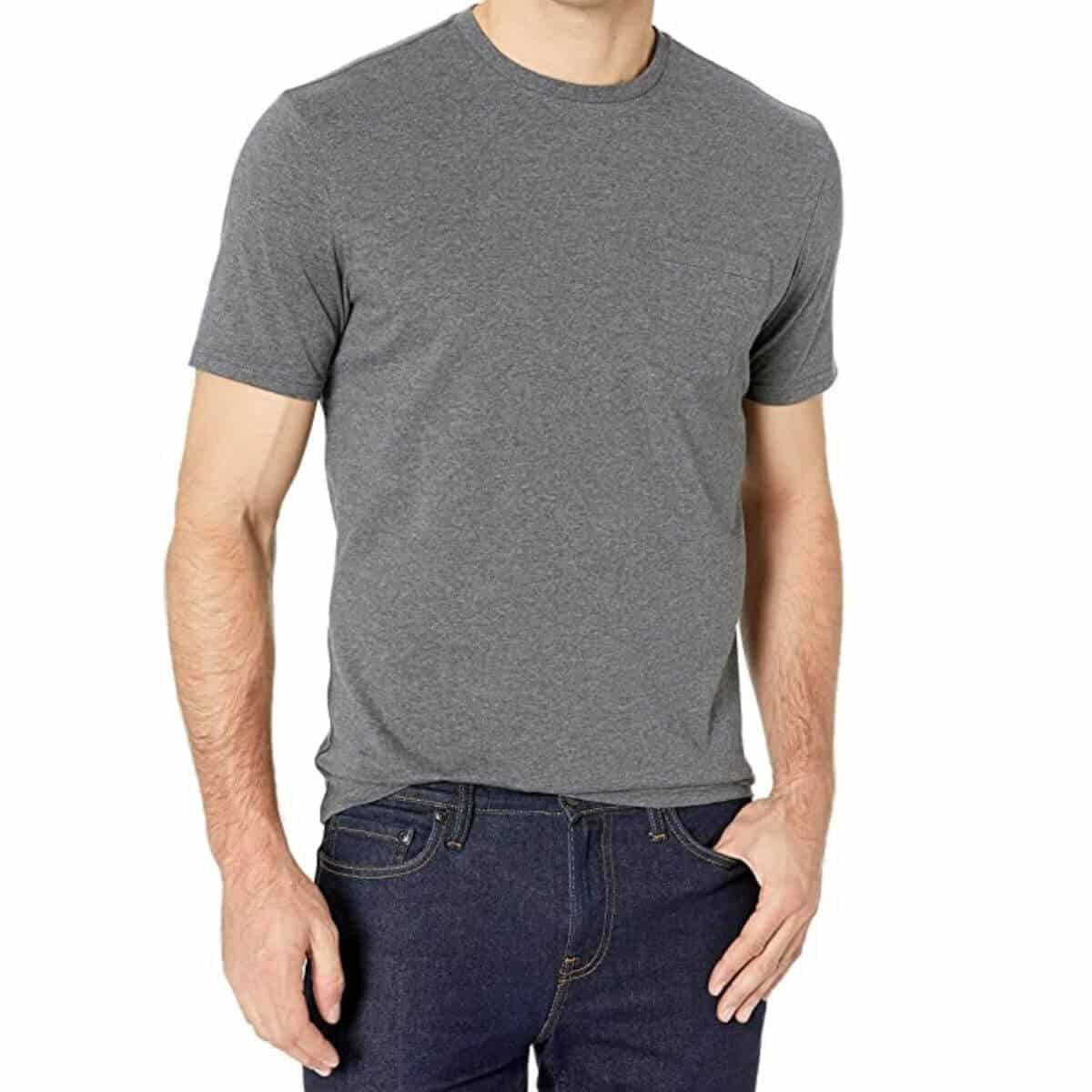 Top half of a person wearing a grey t-shirt and blue jeans.