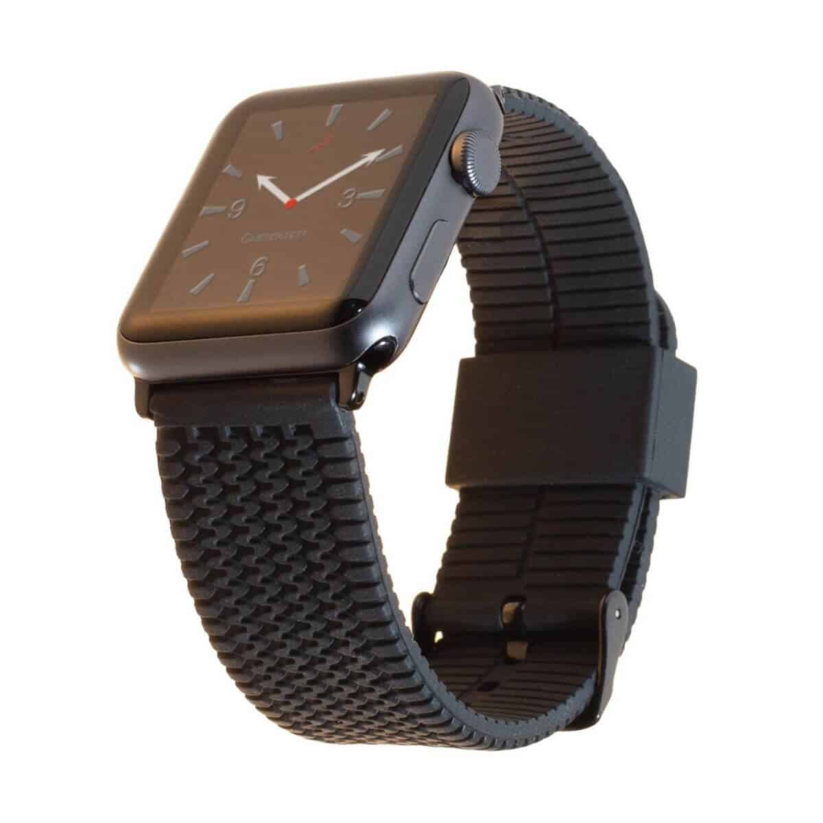 Apple Watch with a black silicone band that has a tire tread pattern.