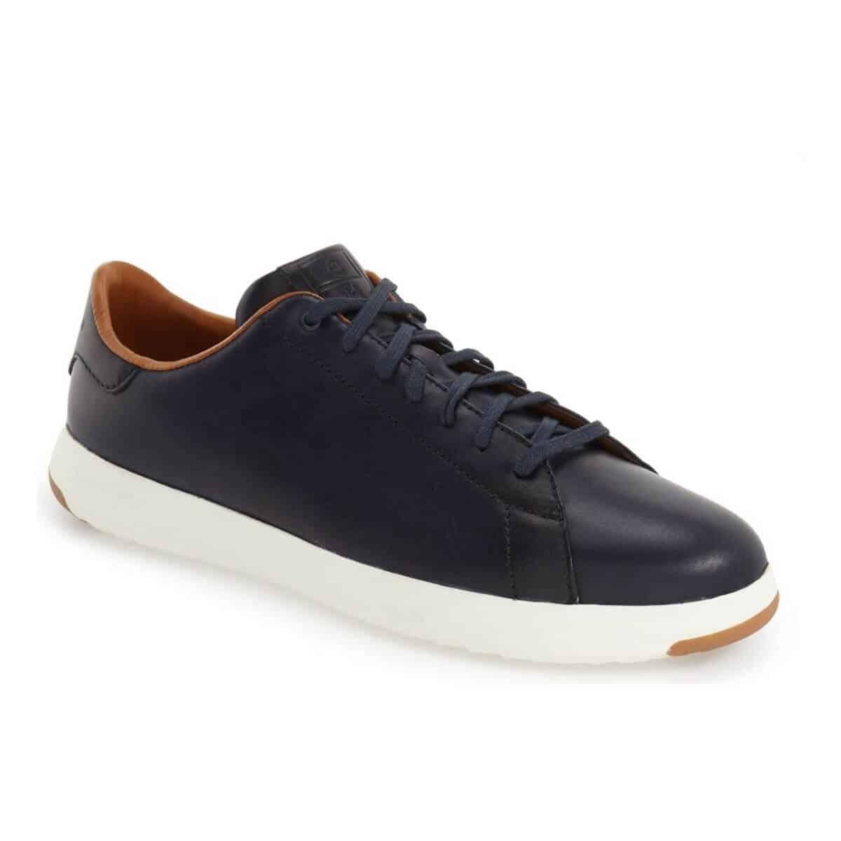 Cole Haan low-top navy blue sneakers.