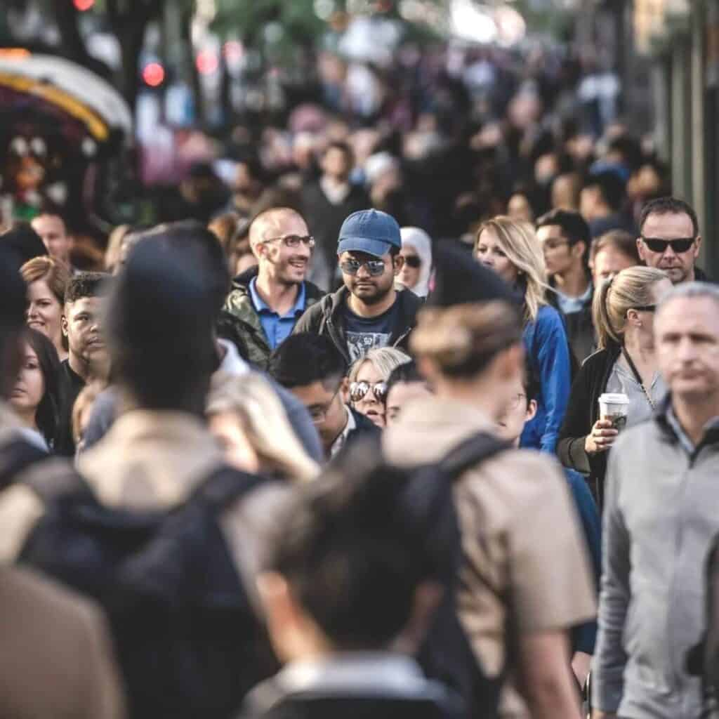Large crowd walking in the city.