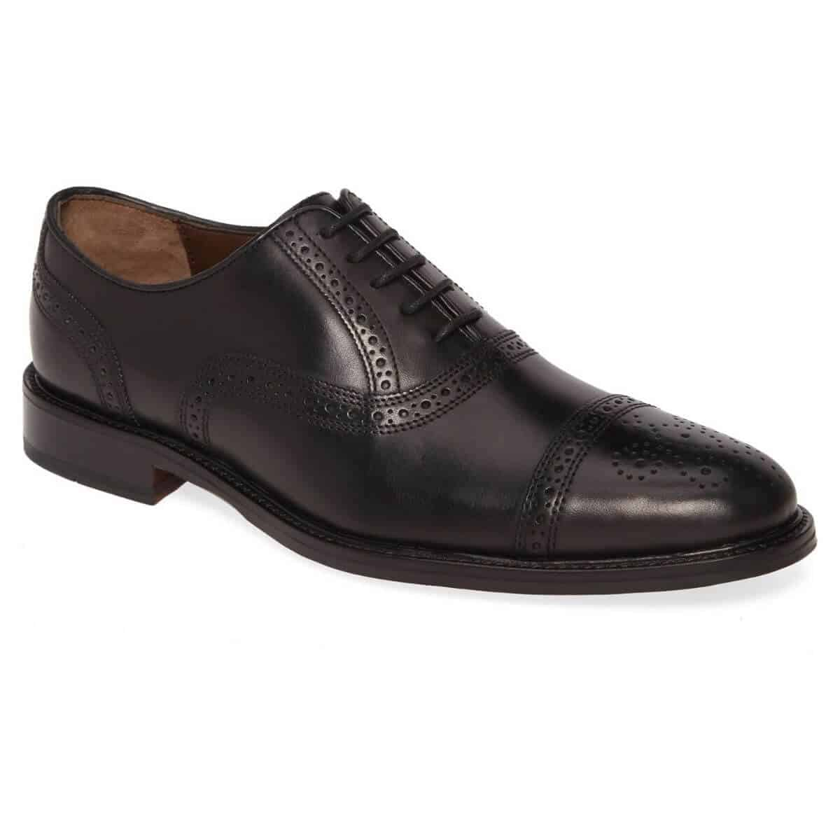 Black leather cap-toe Oxford shoe.