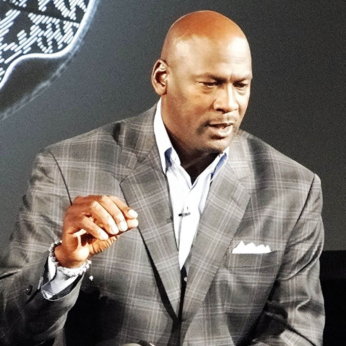 Michael Jordan talking while seated.