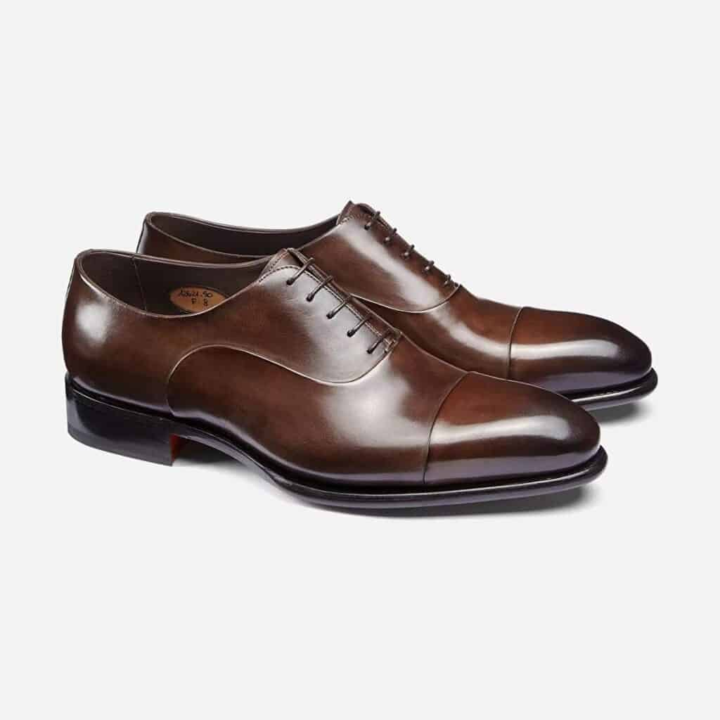 Two dark brown Oxford shoes.