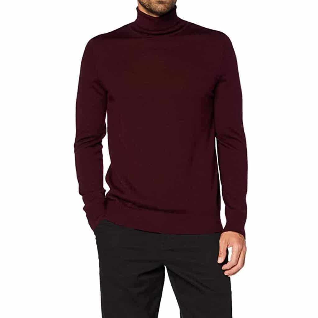 Person wearing a burgundy turtleneck sweater.