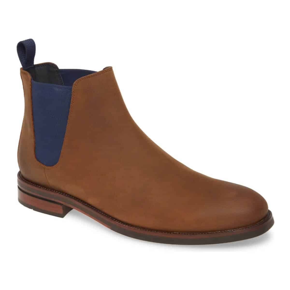 Cole Haan brown suede Chelsea boot with a navy blue side panel.