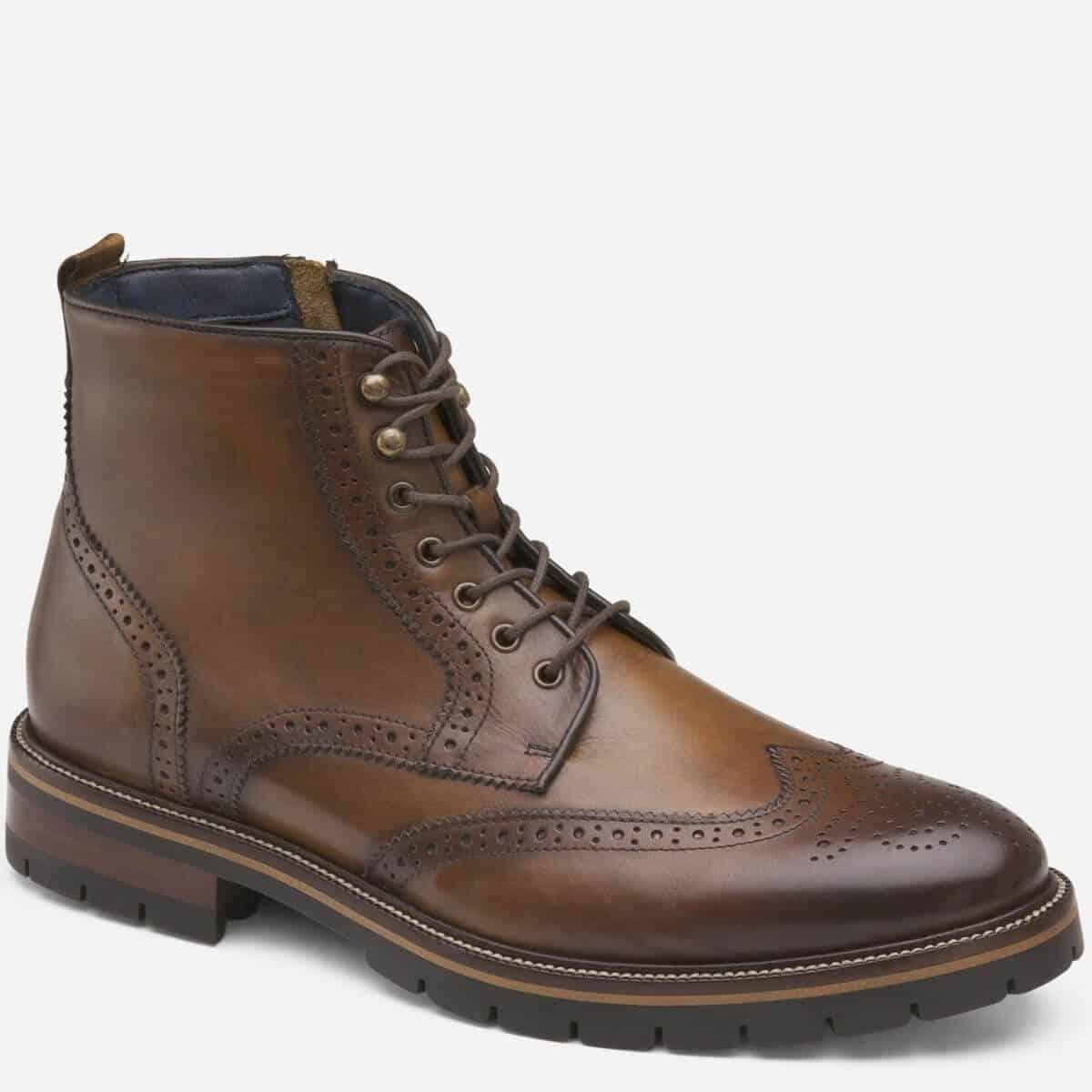 Brown leather wingtip brogue boot.