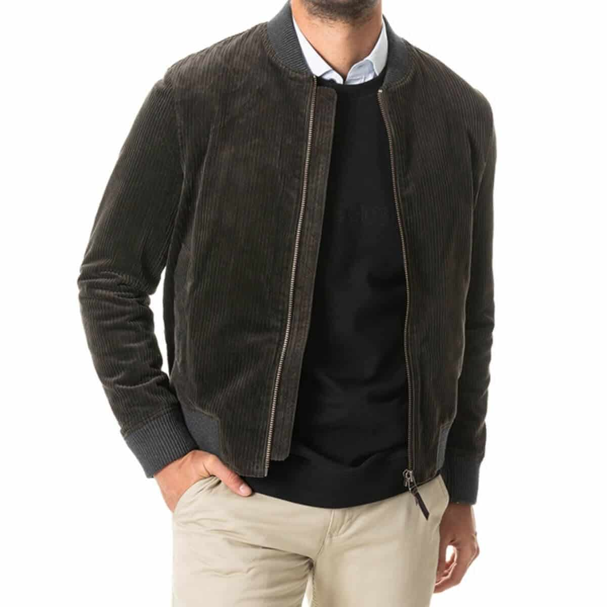 Close-up of a person wearing a corduroy bomber jacket with khaki pants.