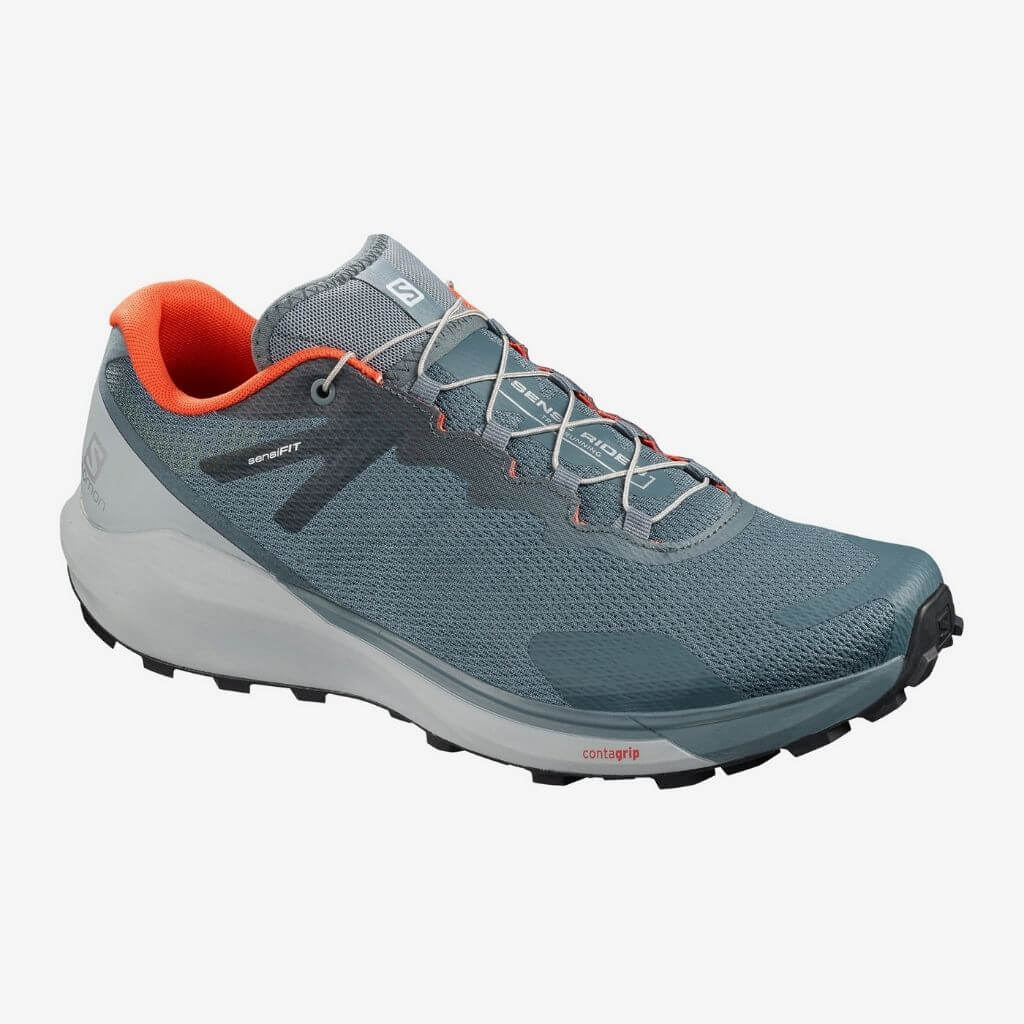 Blue, grey, and orange trail running shoe.
